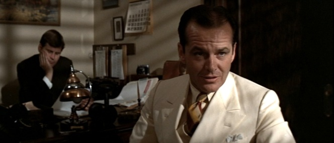 Note Bruce Glover in the background as one of Gittes' assistants. Glover had played obnoxiously campy hitman Mr. Wint in the obnoxiously campy Diamonds are Forever three years earlier.