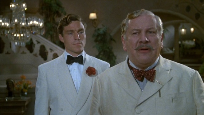 Redfern nails it while Poirot's eccentric taste prevents him from even entering the same sartorial arena.