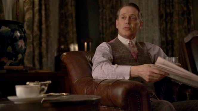Nucky does a lot of newspaper reading in this suit.