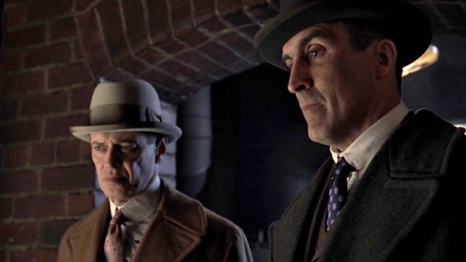 Nucky sports a Capone-like gray homburg as he transforms deeper into his role as gangster.