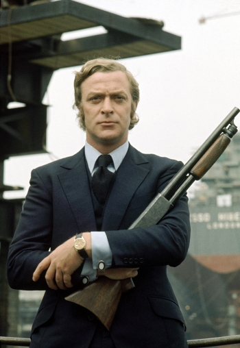 A promotional photo of Michael Caine as Carter, handling a sawed-off Ithaca 37 shotgun that was actually used by Peter (Tony Beckley), another gangster in the film.