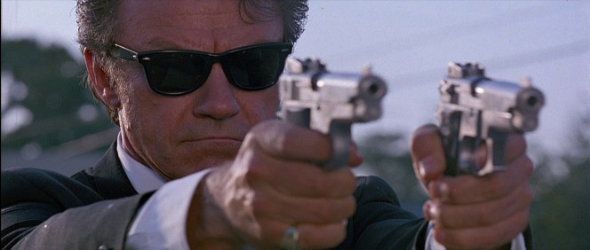 Mr. White takes aim with his S&W 659 in his right hand and his personal S&W 639 in his left.