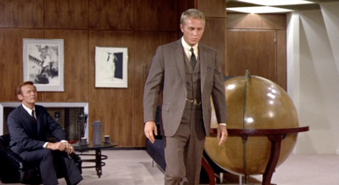 For instance, he's the sort of person who keeps a giant globe in his office.