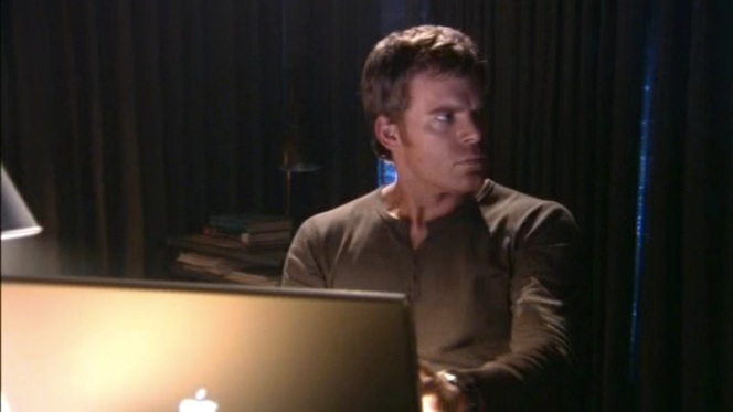 Dex surfs a few criminal databases. Note the brown buttons, indicating a scene from late in the first season.