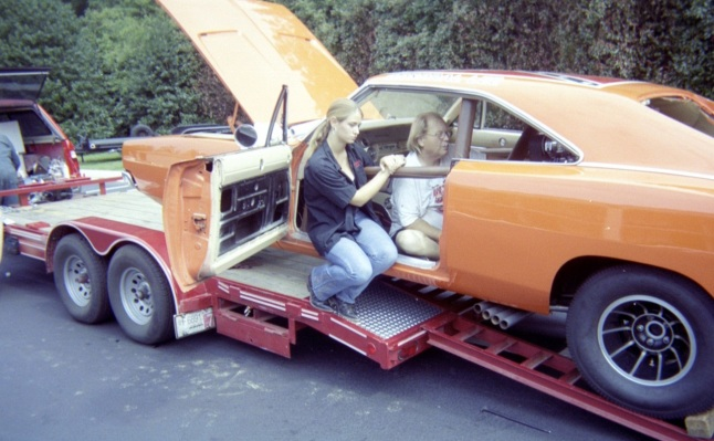 "See? The doors do open! A crew member places the ""roll bars""."
