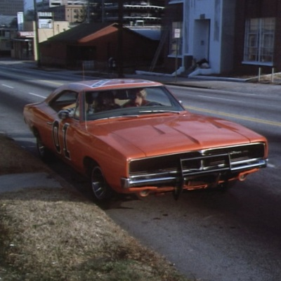 "Bo parks the General Lee in Atlanta during ""Daisy's Song"" (Episode 1.02)."