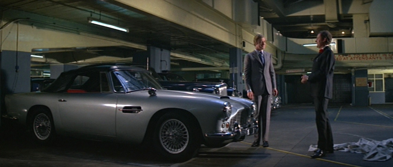 Aston Martin Newport Pagnell >> The Italian Job: A Gray Tailored Suit and '62 Aston Martin   BAMF Style