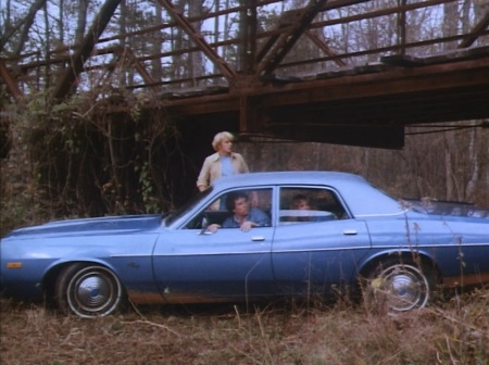 "Luke behind the wheel of Cooter's Fury in ""Mary Kaye's Baby"" (Episode 1.03). Mary Kaye herself can be spotted in the back seat behind Luke."