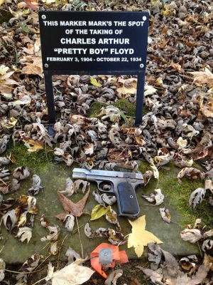 I brought my own personal .32 Colt (certainly lighter than the .45s that Floyd favored!) to mark the spot. Unlike visitors before me, I chose not to fire it into any of the site's markers. (Note the grammatical error on the black sign here!)
