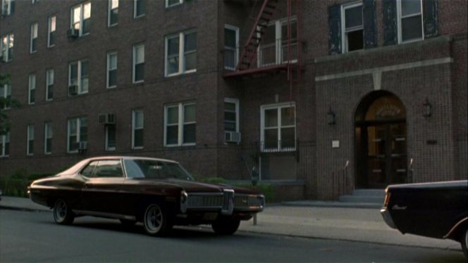 Henry's '68 Pontiac, parked in front of his goomah's place.