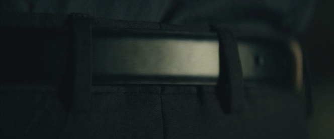 The movie wants to make sure we know that John Wick WEARS A BELT.