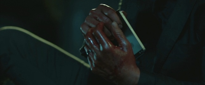 The blood covering Wick's hands isn't a spoiler;. this is literally from the first scene in the movie.