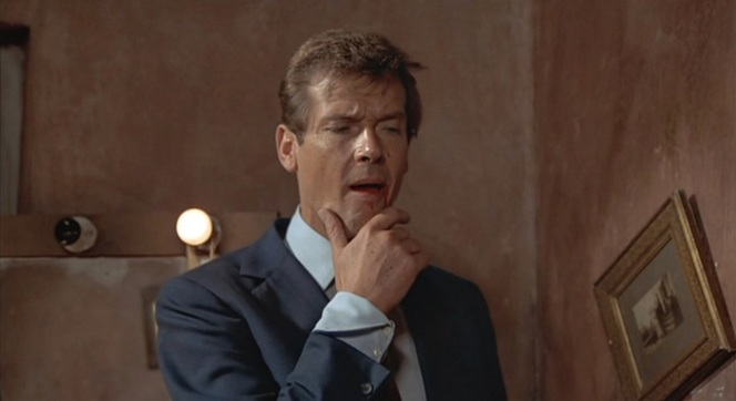 A victorious Roger Moore studies his conquered foe.