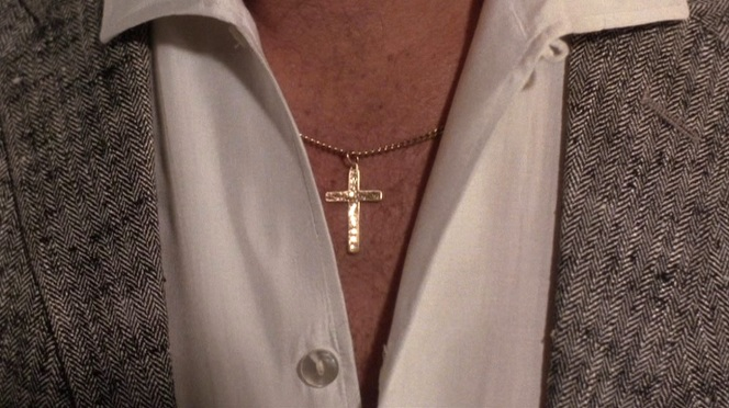 The first thing Karen sees when she greets Henry for their date? A gold cross that her Jewish family will be sure to notice if she doesn't button up his shirt!