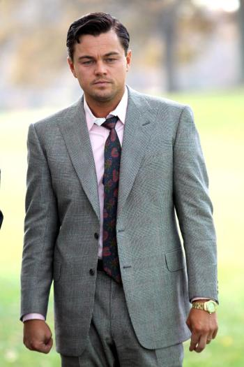 A behind-the-scenes shot of DiCaprio filming the scene offers the best look at his tie under the open jacket.