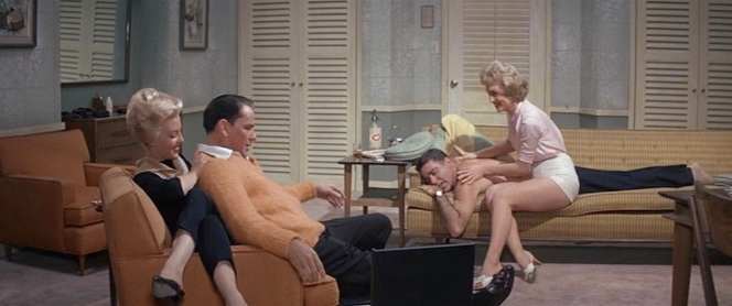 Peter Lawford dresses much less modestly for his massage.