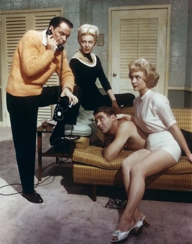 Frank Sinatra and Peter Lawford with female admirers in Ocean's Eleven (1960).