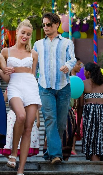 Johnny Depp as Paul Kemp in The Rum Diary (2011), with co-star Amber Heard.