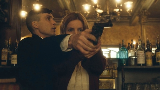 Tommy gives Grace a hands-on tutorial in firing a Webley revolver, not realizing that she's no stranger to shooting others.
