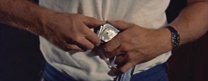 Jim's watch is best seen when he's unloading Plato's pistol.