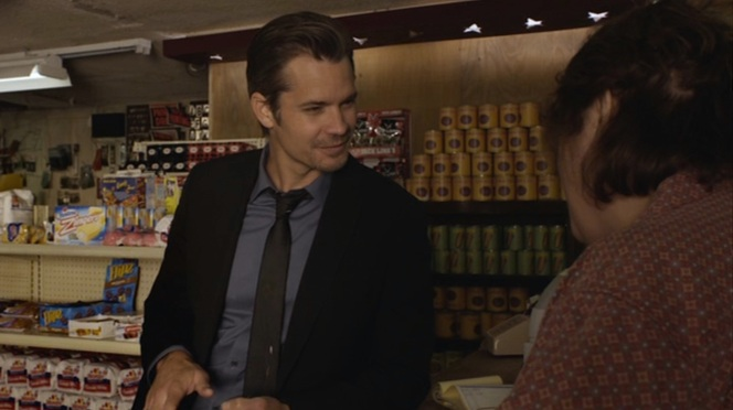 "Raylan can't resist a swallow of the titular beverage in ""The Moonshine War"" (Episode 2.01)."