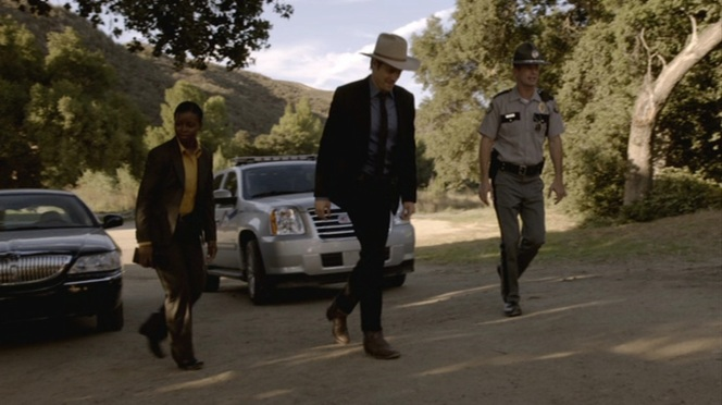 "Raylan bridges the gap between Rachel's professional U.S. Marshal duds and the Kentucky state trooper's more traditional uniform in ""The Moonshine War"" (Episode 2.01), although neither Rachel nor the trooper have the gumption to pull off a pair of ostrich leg boots."