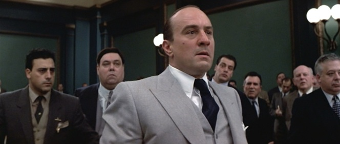 Capone's dark navy tie is best seen as he receives the horrifying news that he'll be receiving a fair trial.