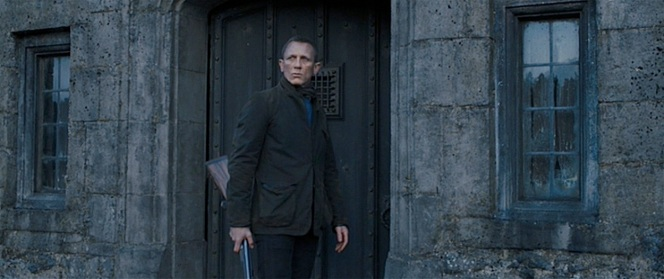 Bond stands ready for action in front of Skyfall Manor.