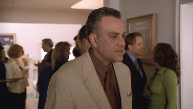 """Johnny Sack greets his guests in """"Employee of the Month"""" (Episode 3.04)."""