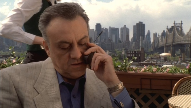 Johnny Sack takes his prison phone calls al fresco.