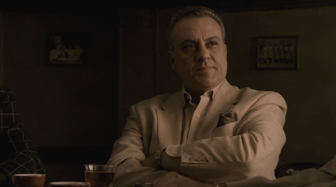 Although decked out in warm colors, Johnny Sack provides a dangerous contrast against the scene's darkness.