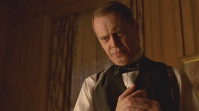 Nucky spends the early hours of 1923 in his office, drinking alone.