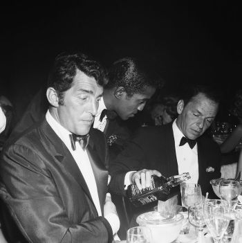 Sinatra enjoys his favorite whiskey with his best pals Dean Martin and Sammy Davis, Jr.