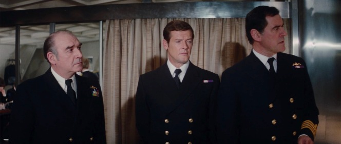 Vice-Admiral Hargreaves (Robert Brown), Commander Bond, and Captain Benson (George Baker, who previously portrayed Sir Hilary Bray in On Her Majesty's Secret Service) consult in their Blue No. 1C service dress.