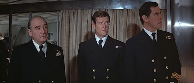 Bond meets with fellow naval officers in their Blue No. 1C dress uniforms.