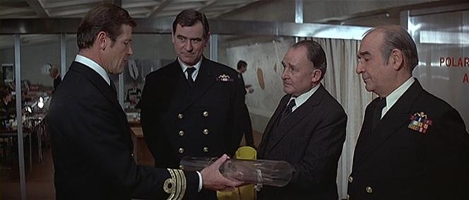 Commander Bond shows off his rank.