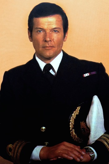 """Roger Moore sports Commander Bond's service dress uniform in this publicity photo for The Spy Who Loved Me as well as his """"Pepsi bezel"""" Rolex GMT Master rather than the digital SEIKO he wears on screen."""