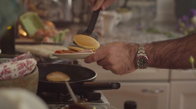 Rob wears his GMT Master while prepping breakfast.