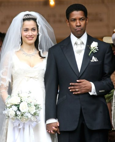 Denzel Washington and Lymari Nadal as Frank Lucas and Eva Lucas in American Gangster (2007).