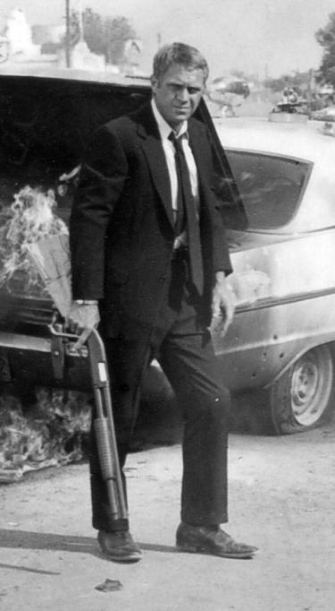 """Steve McQueen as Carter """"Doc"""" McCoy in The Getaway (1972)."""