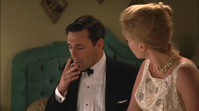 Even during a conversation with his wife, Don takes an especially strong drag on his Lucky to remind us that he is Don Draper.