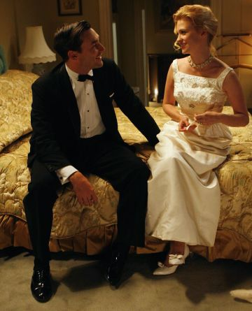 A production photo of Jon Hamm and January Jones.