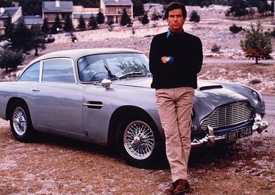 A publicity shot of Pierce Brosnan with the GoldenEye DB5.