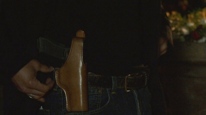 Raylan's Glock remains holstered by his side at all times.