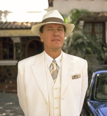 Geoffrey Rush as Harry Pendel in The Tailor of Panama (2001).