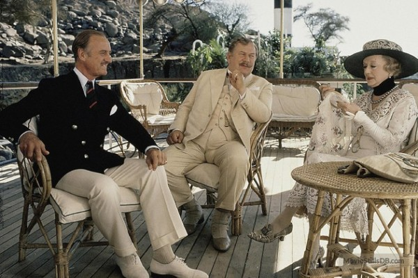 Another promotional photo, this time featuring Niven with Peter Ustinov and Bette Davis.