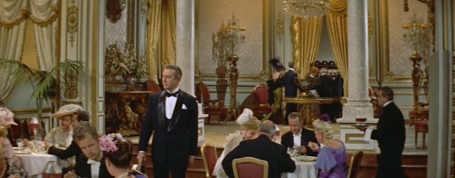 Stanford White moves through the tailcoat-clad restaurant in his slightly less formal dinner jacket.