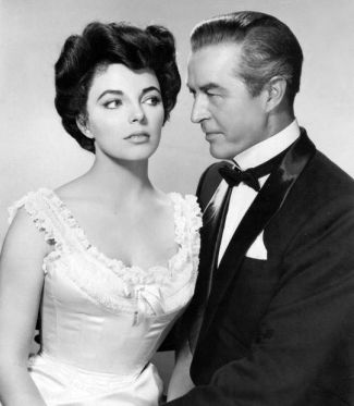Joan Collins and Ray Milland in a promotional photo for The Girl in the Red Velvet Swing (1955).