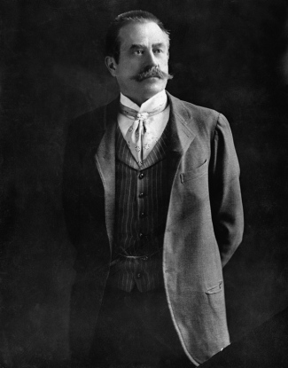 The real Stanford White, in fact a heavily mustached man, sometime in the early 1900s as he would have looked around the time he seduced Evelyn Nesbit.