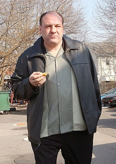 "James Gandolfini on set in Bloomfield, NJ as Tony Soprano, filming ""Made in America"" (Episode 6.21), the series finale of The Sopranos. (Taken by Arnaldo Magnani for Getty Images, March 22, 2007.)"